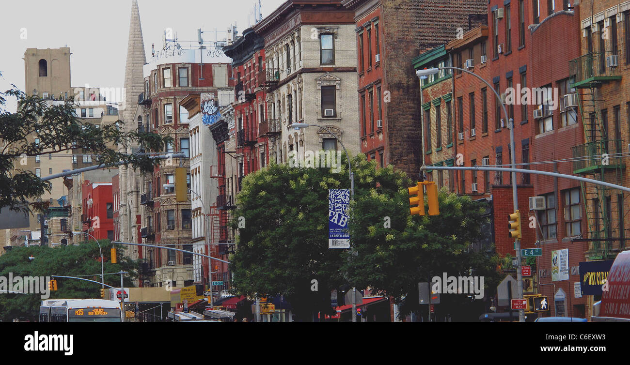 NYC, Busy neighborhood with trees. Brick buildings, apartments. - Stock Image