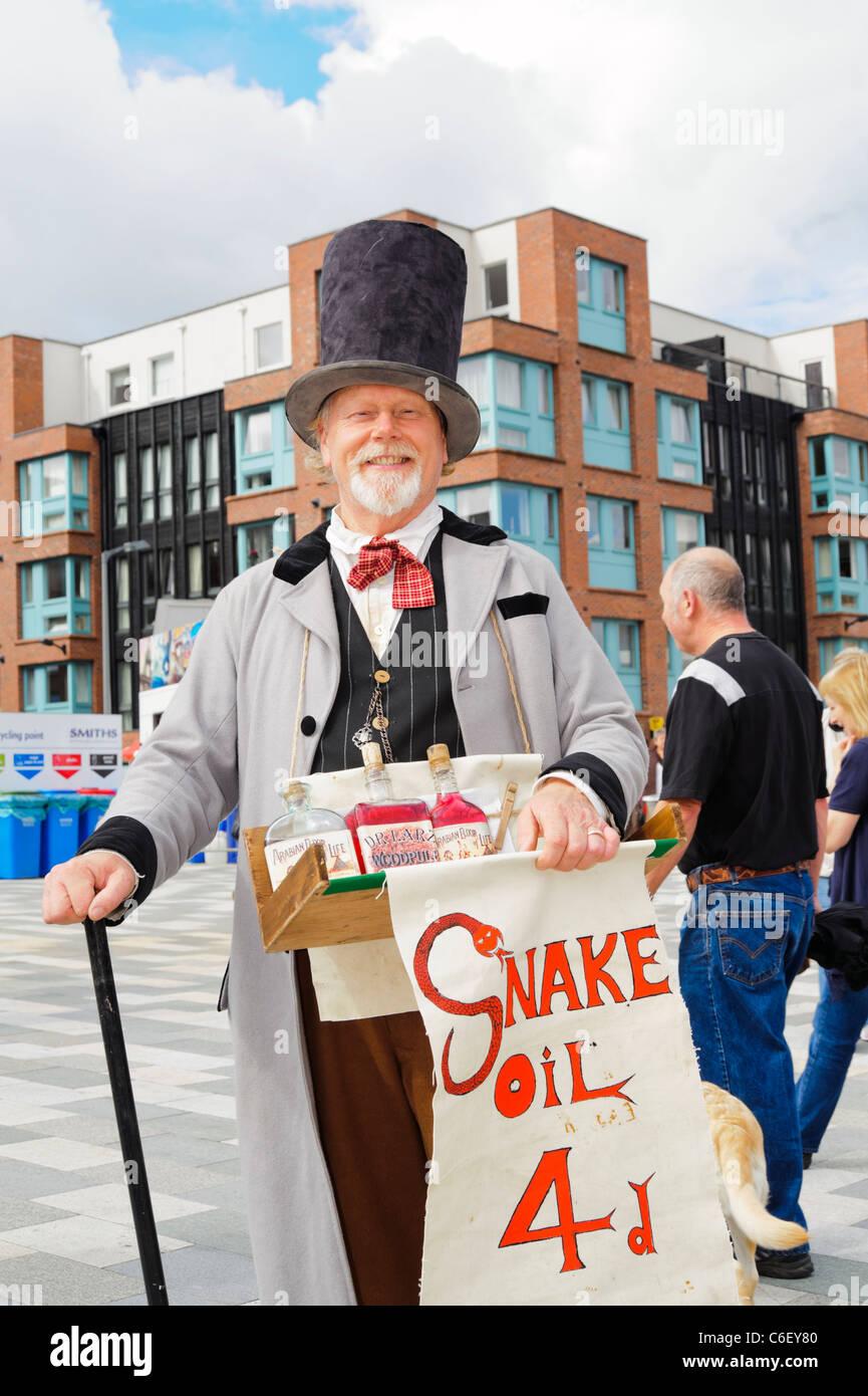 Snake Oil salesman at Gloucester Docks, England, UK. Man in period costume selling snake oil. - Stock Image