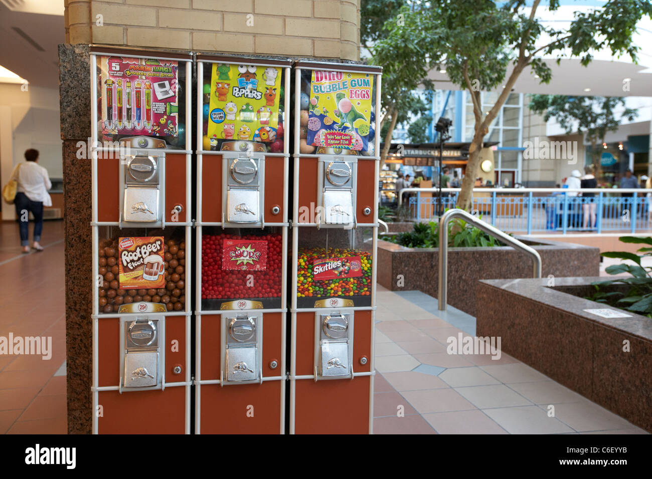 candy sweets coin operated dispensers in a shopping centre mall winnipeg manitoba canada - Stock Image