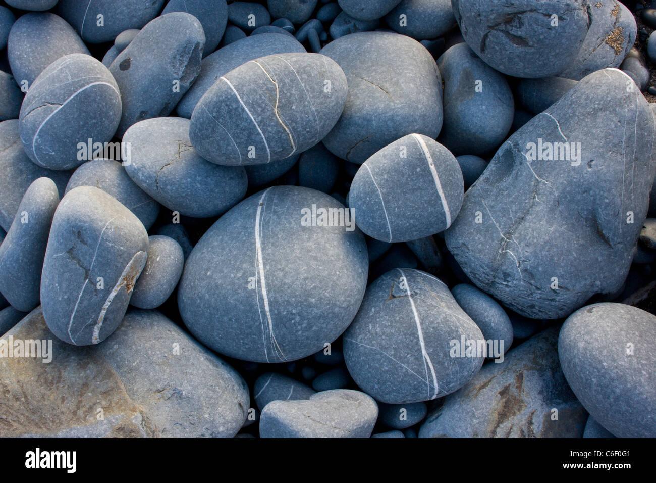 Rounded sandstone beach pebbles at Hartland Quay, north Devon. - Stock Image