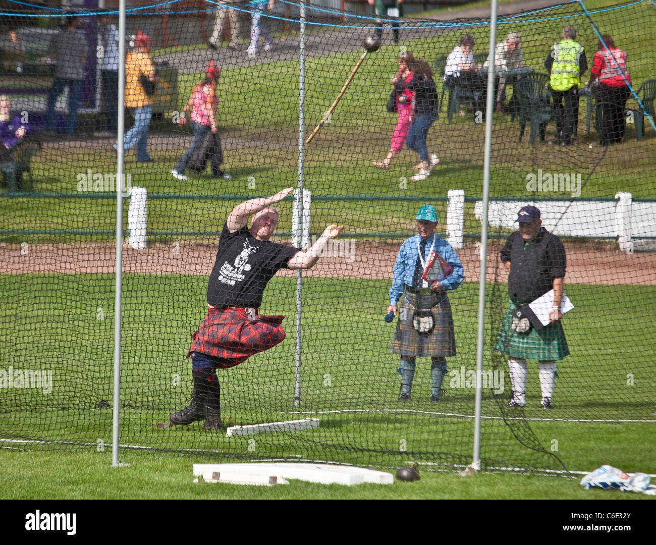 Competitor throwing the hammer, Scottish standing style, in the Heavy Events at the Cowal Highland Gathering 2011 Stock Photo