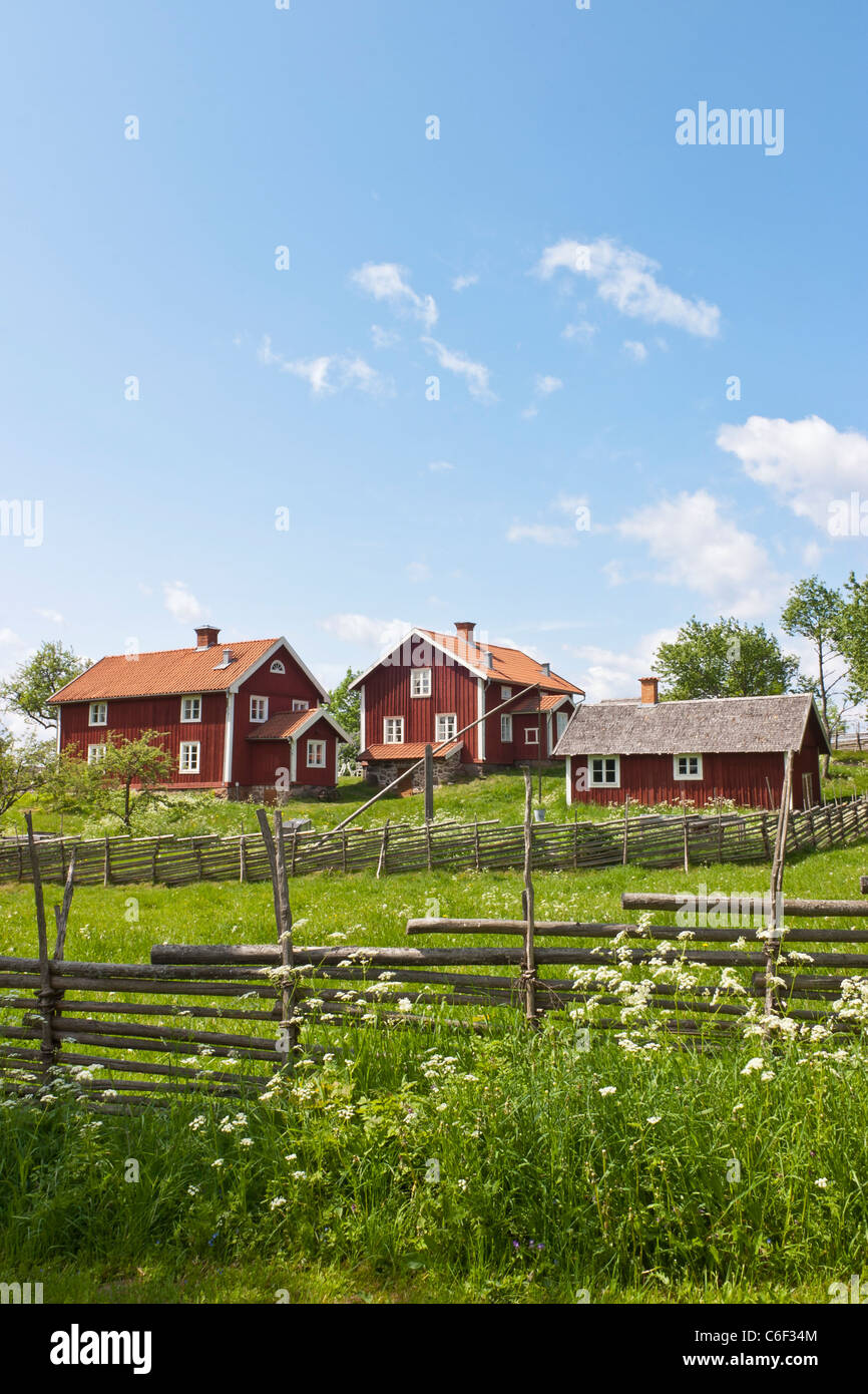 Old farm on a hill in an idyllic Swedish countryside landscape, Åsensby Småland. - Stock Image