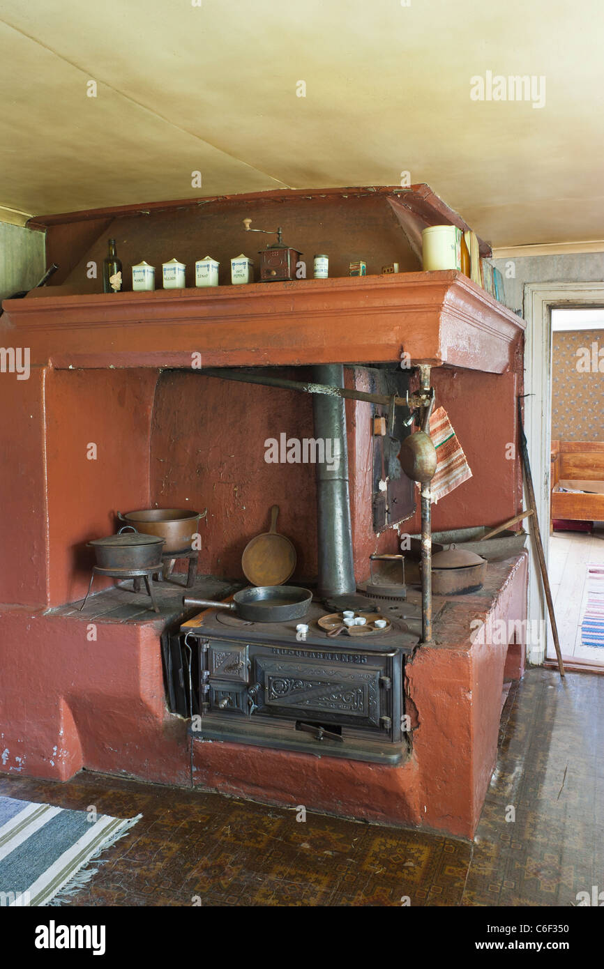 Old kitchen in a cottage with a wood fired stove - Stock Image