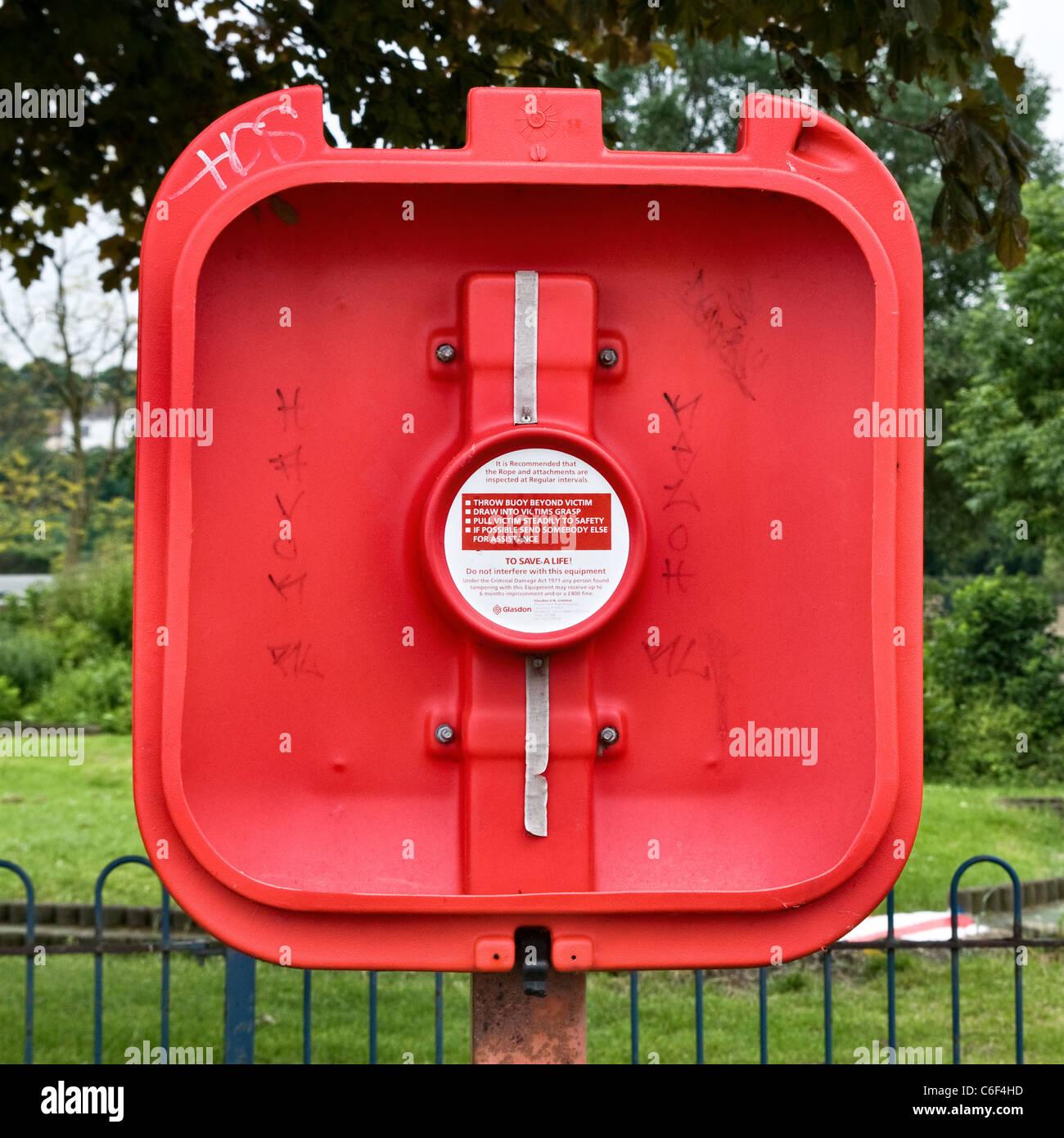 Vandalized swimming life saving buoyancy aid box - Stock Image
