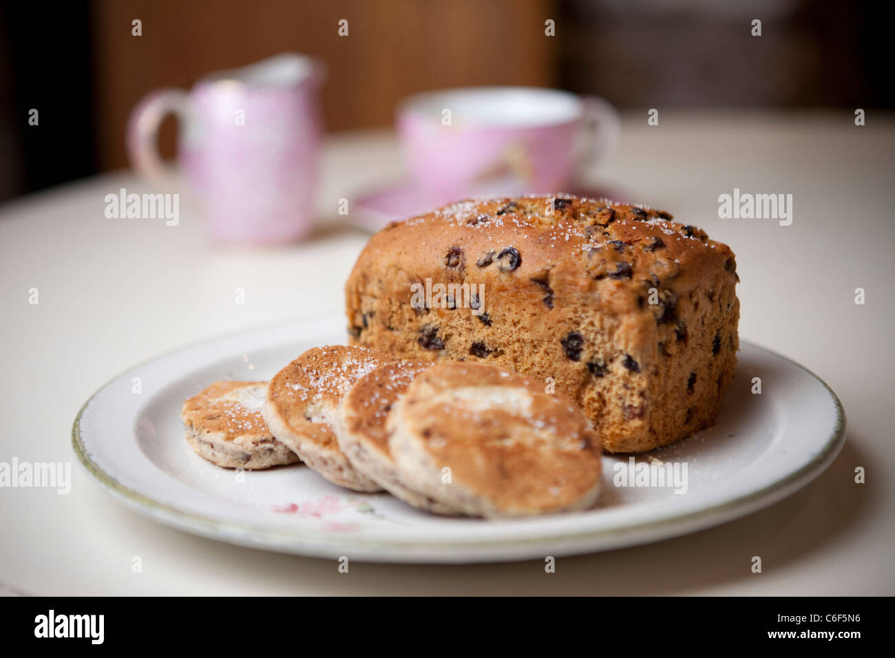 A Home Made Fruitcake Or Bara Brith Alongside Some Sugar Dusted Welsh Stock Photo Alamy