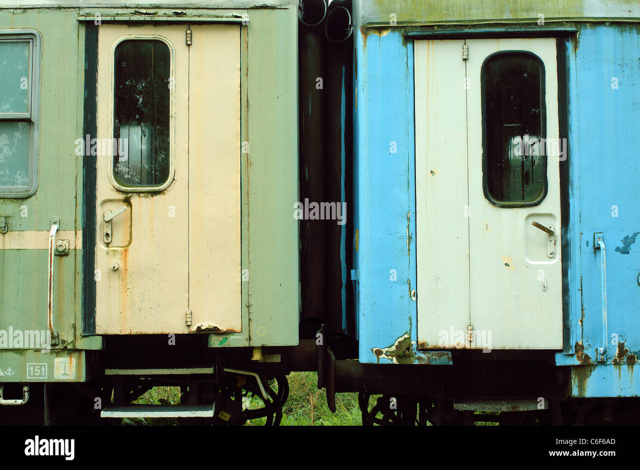Closed doors of  the two abandoned carriages - Stock Image