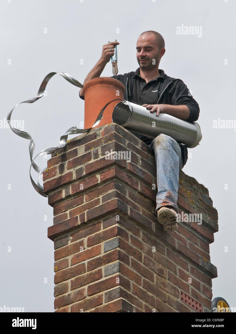 Lining a chimney for wood burning - Stock Image