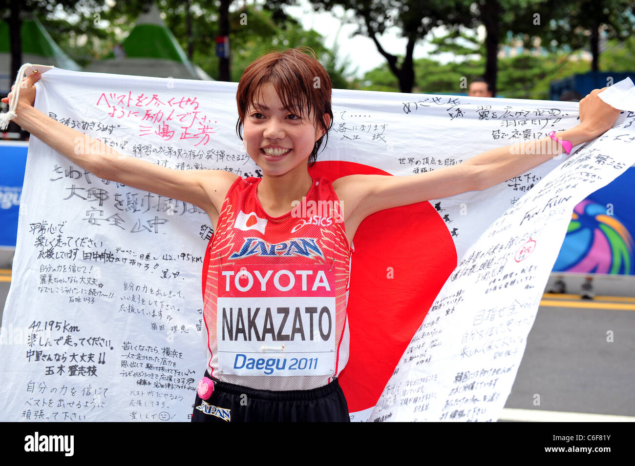 Remi Nakazato (JPN) posing for pictures after running for the 13th IAAF World Championships in Athletics. - Stock Image
