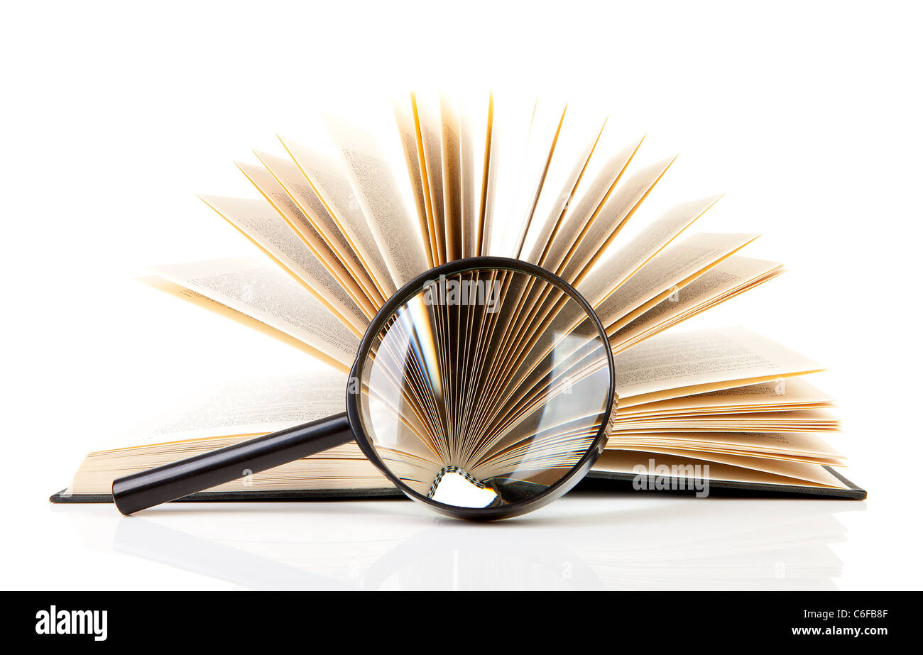 open book with magnifying glass over white background - Stock Image