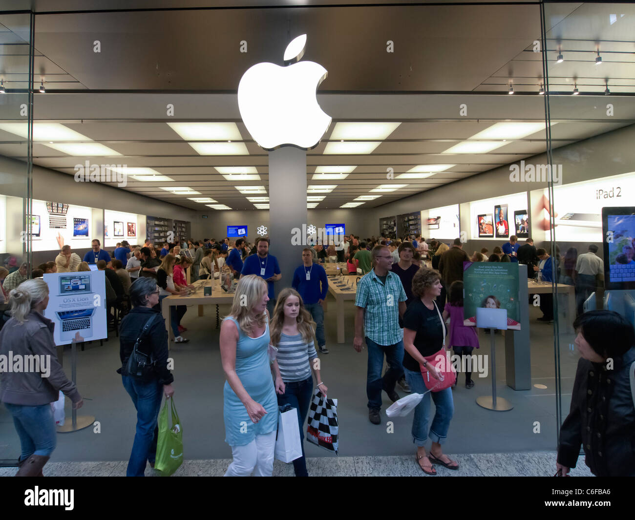 Busy Apple shop at Centro one of Europe's largest shopping mall in Oberhausen Germany Stock Photo