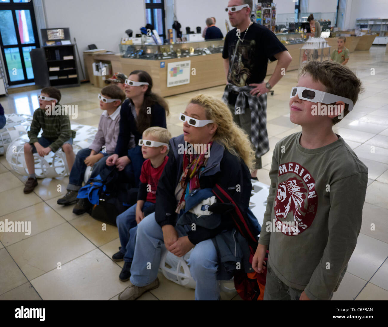 Visitors watch 3D film with 3D glasses at the Deutsches Bergbau-Museum or German Mining Museum in Bochum Germany - Stock Image