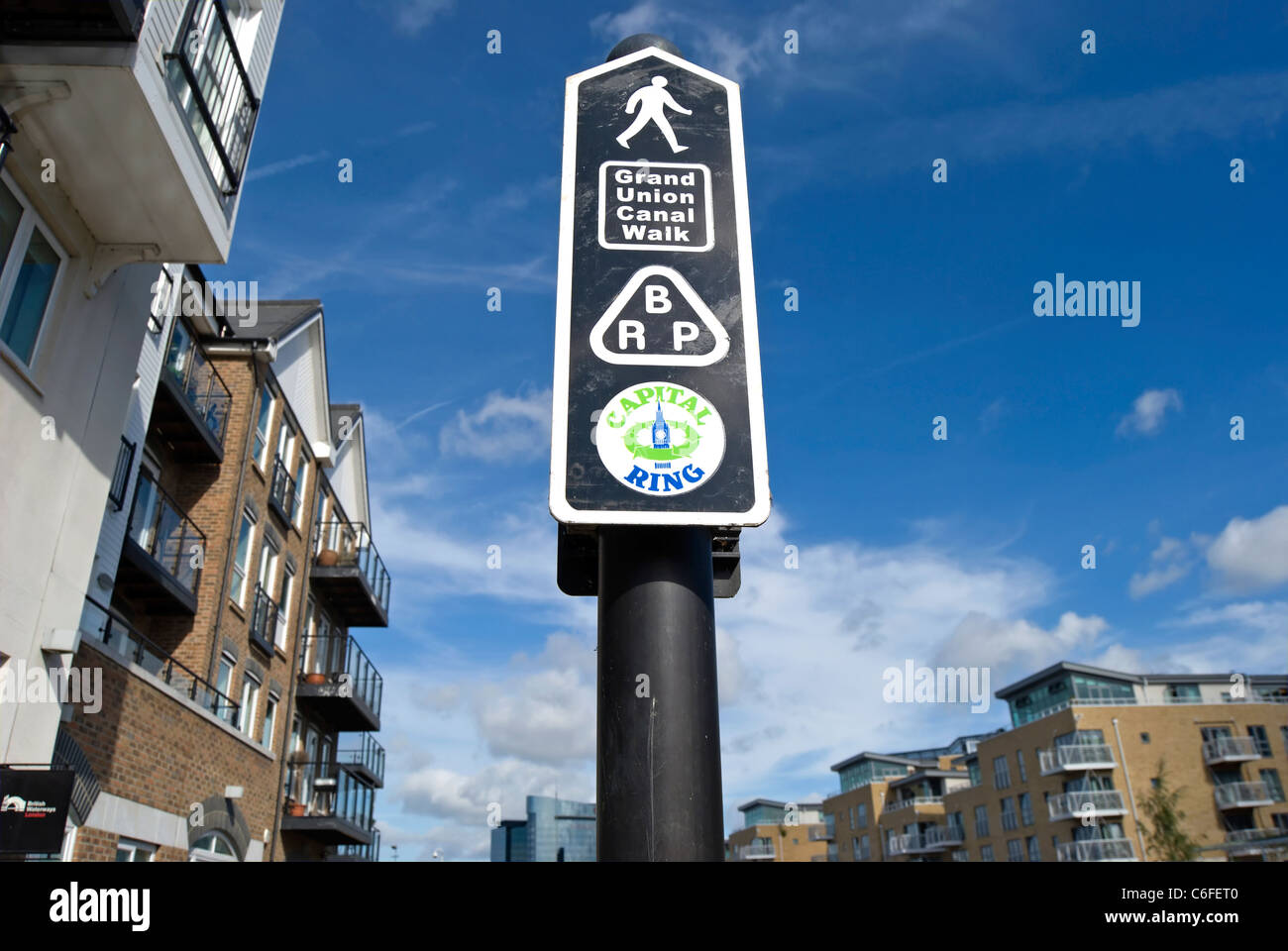 signpost showing walking routes for the grand union canal, brp, and capital ring, at brentford lock, west london, - Stock Image