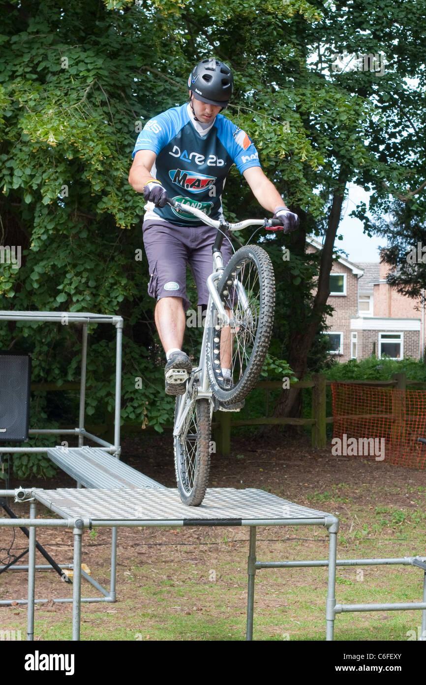 Bike stunt show by M.A.D in June 2011 at Nowton Park, Bury St Edmunds, UK. - Stock Image