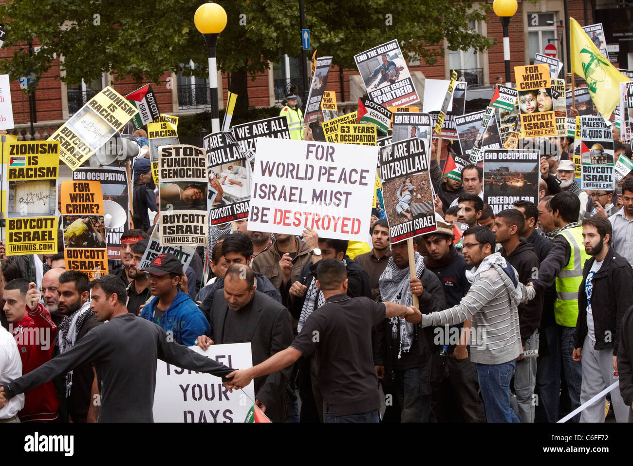 The 2011 Al Quds Day march, calling for a boycott of Israeli products and a free Palestine, takes place in London. - Stock Image