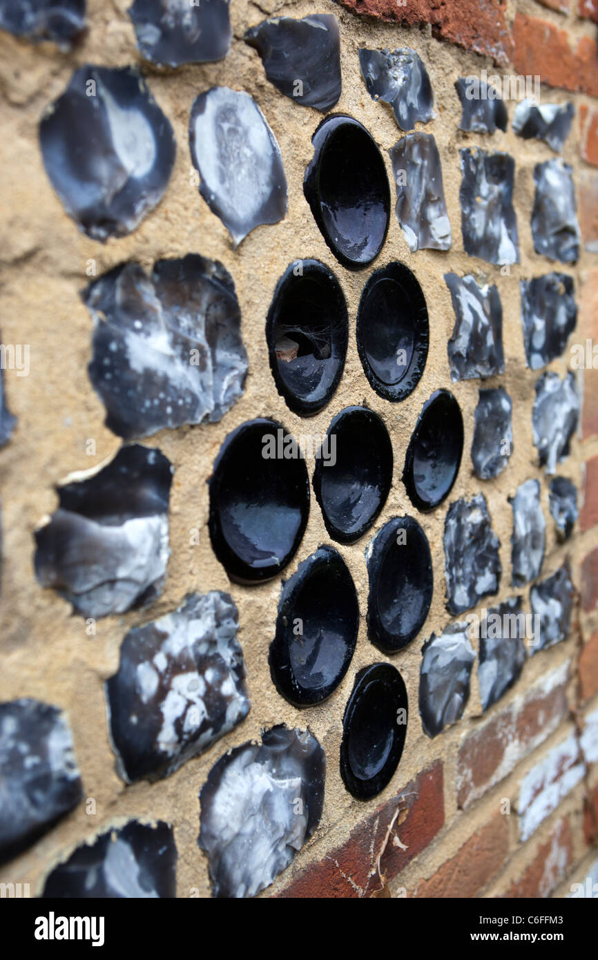 Glass Bottles in the wall of The Old Village Lock up at Great Bedwyn Wiltshire - Stock Image