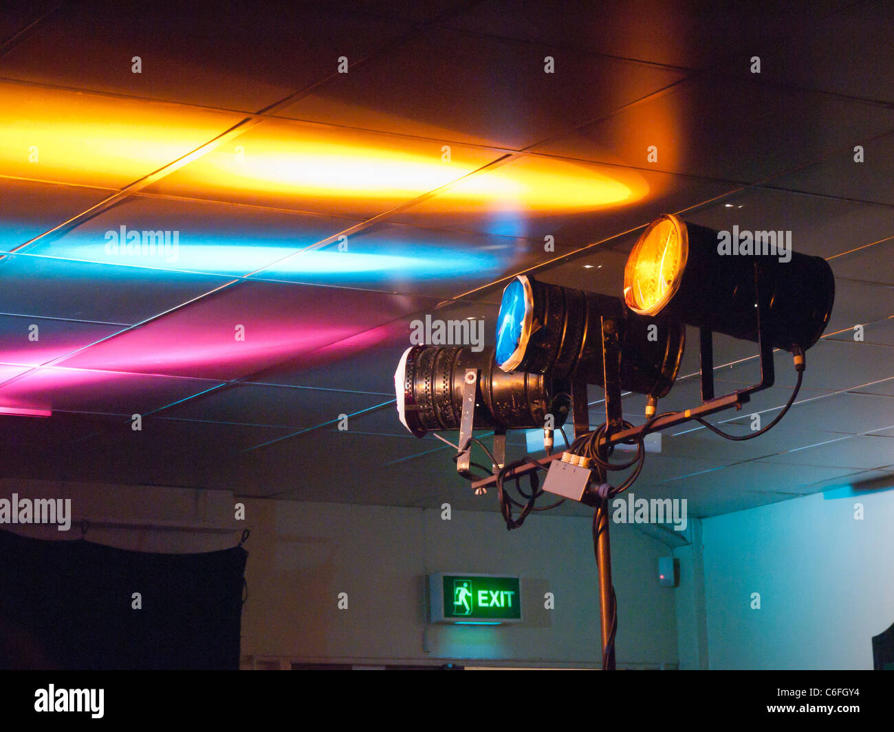 stage lights make a coloured pattern on the ceiling at a London blues club - Stock Image