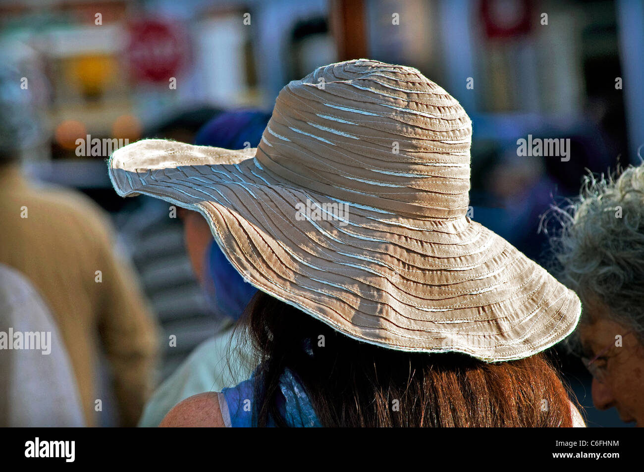 wide brim summer people hat hats - Stock Image 9ddcab2748aa