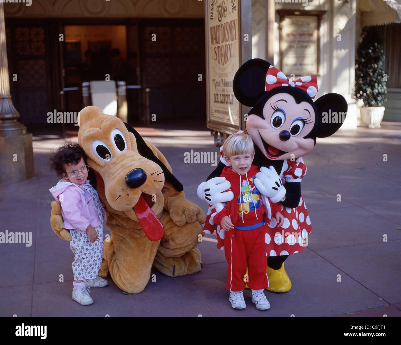 Young children with Pluto and Minnie, Fantasyland, Disneyland, Anaheim, California, United States of America Stock Photo
