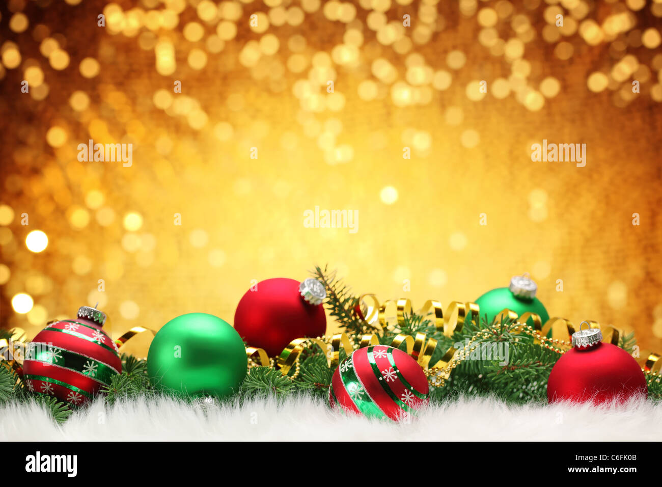 Christmas balls with pine branch on festive background. - Stock Image