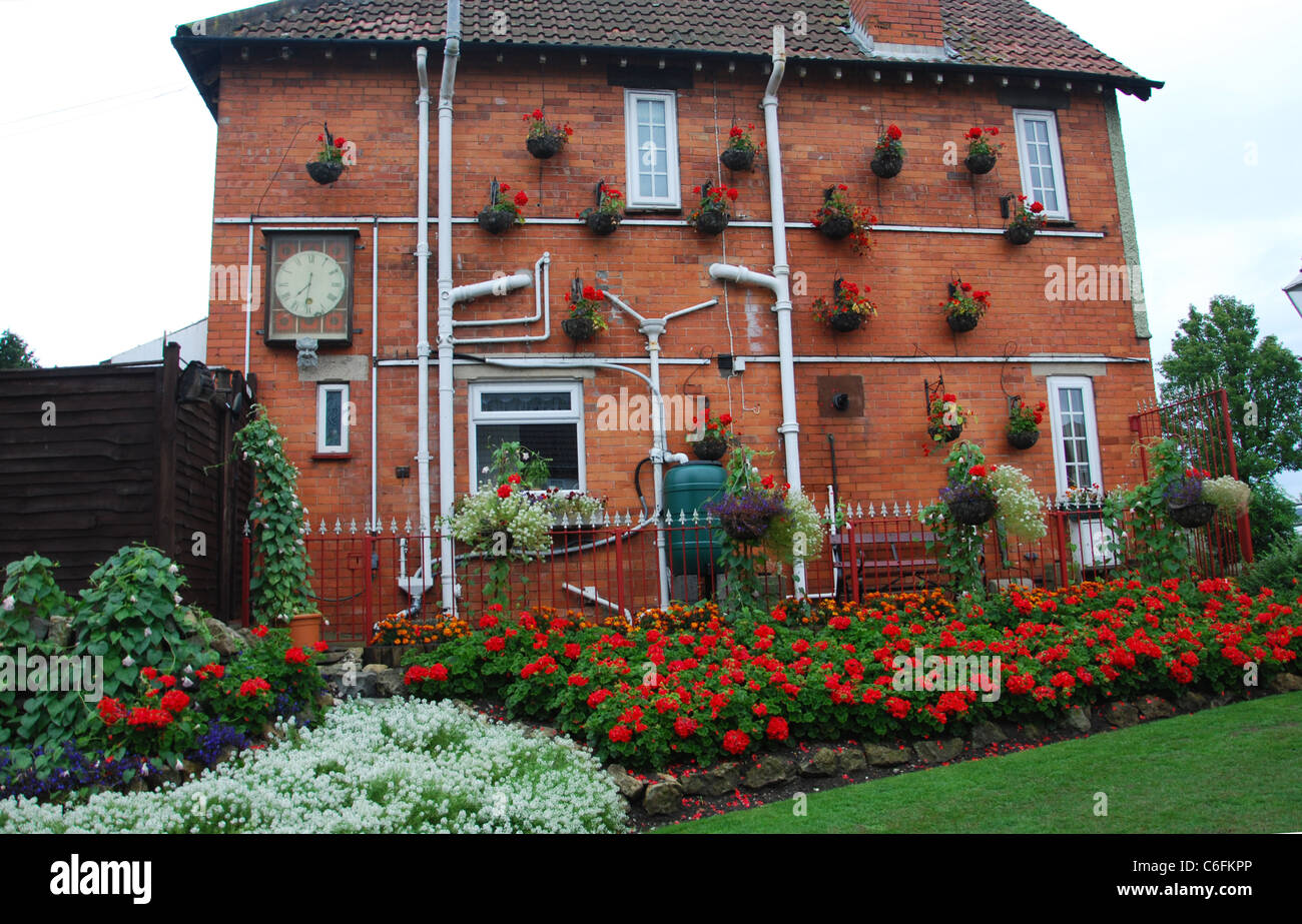 typical house with outside pipework Glastonbury Somerset UK Stock Photo
