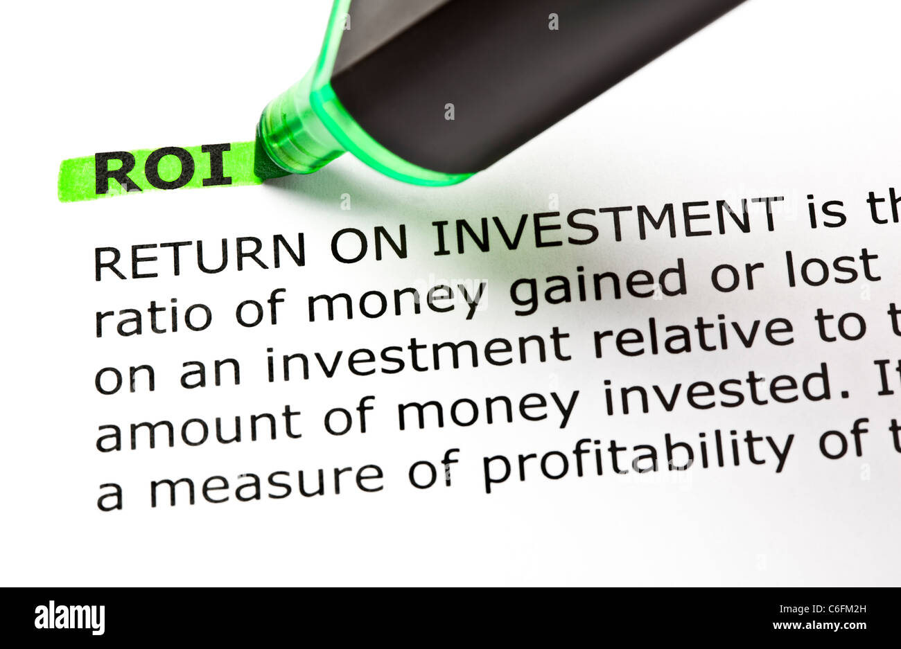 ROI (Return On Investment) highlighted in green with felt tip pen Stock Photo