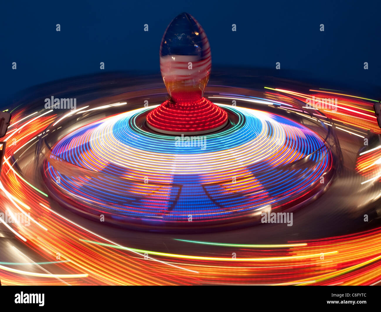 A spinning ride at Goose Fair, Nottingham England UK - Stock Image