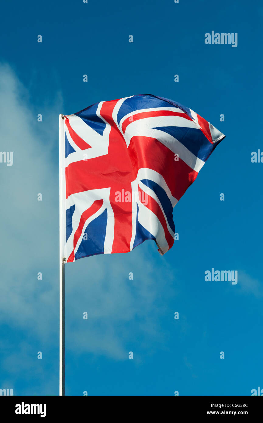 Union Jack flag flapping in the wind - Stock Image