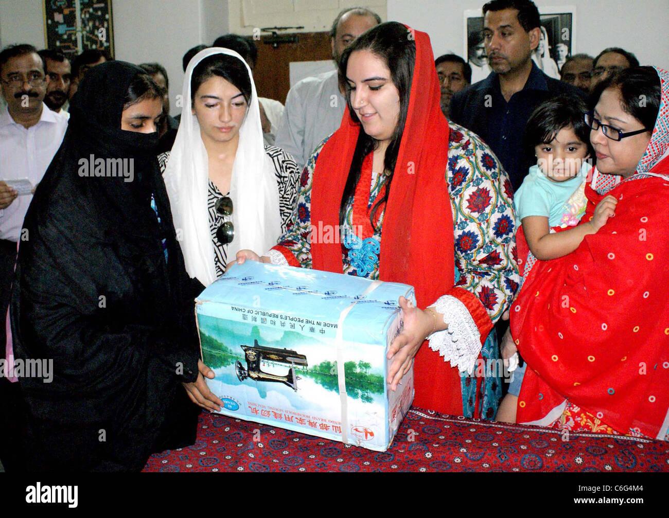 MNA Faryal Talpur along with Bakhtawar Bhutto Zardari and Asifa Bhutto Zardari distribute sewing machines - Stock Image