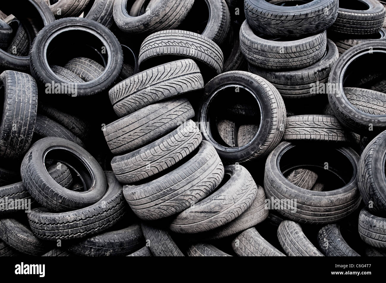 A pile of used tyres - Stock Image