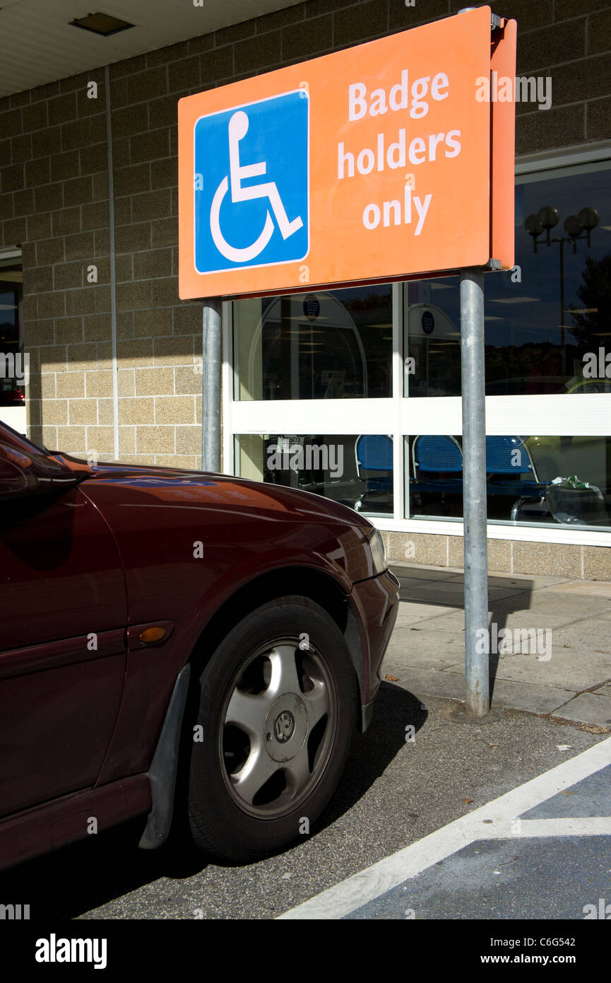 A car parked in blue badge disabled bay in a supermarket, uk - Stock Image