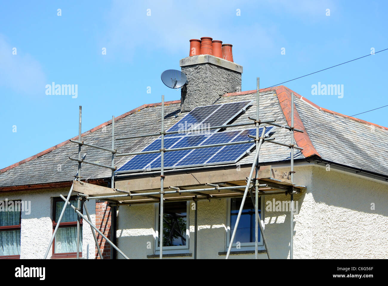 Solar Roof Panels being fitted to suburban house in Manchester, UK - Stock Image