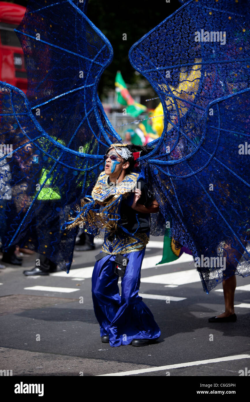 A dancer in a costume at the Notting Hill Carnival, London, England, UK, GB - Stock Image