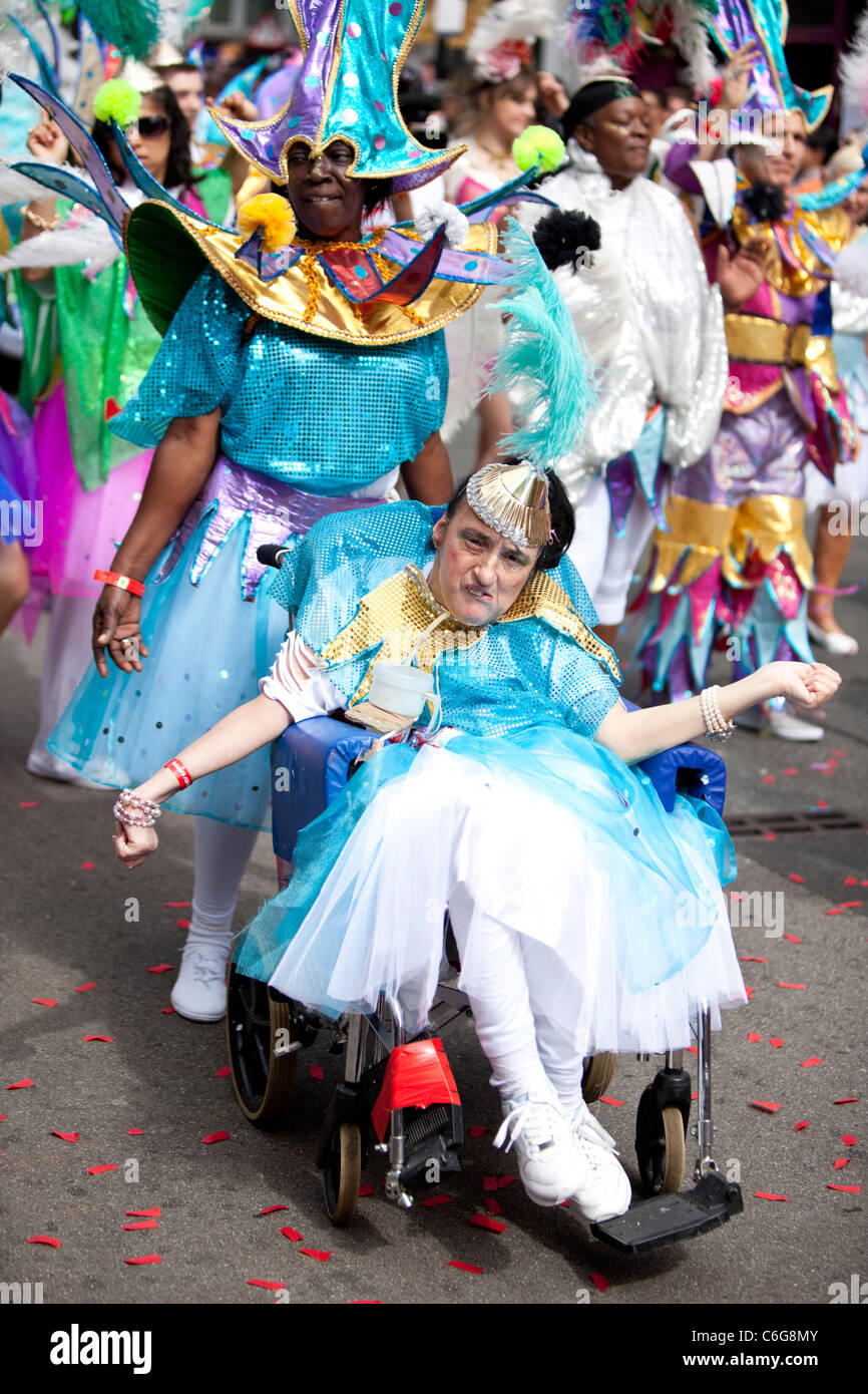 A disabled woman in a costume at The Notting Hill Carnival 2011, London, England, UK - Stock Image