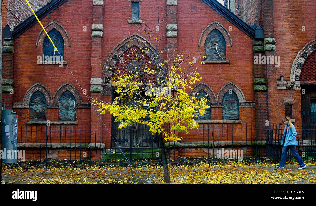 Red brick Gothic Church,Jersey City, in the fall. - Stock Image
