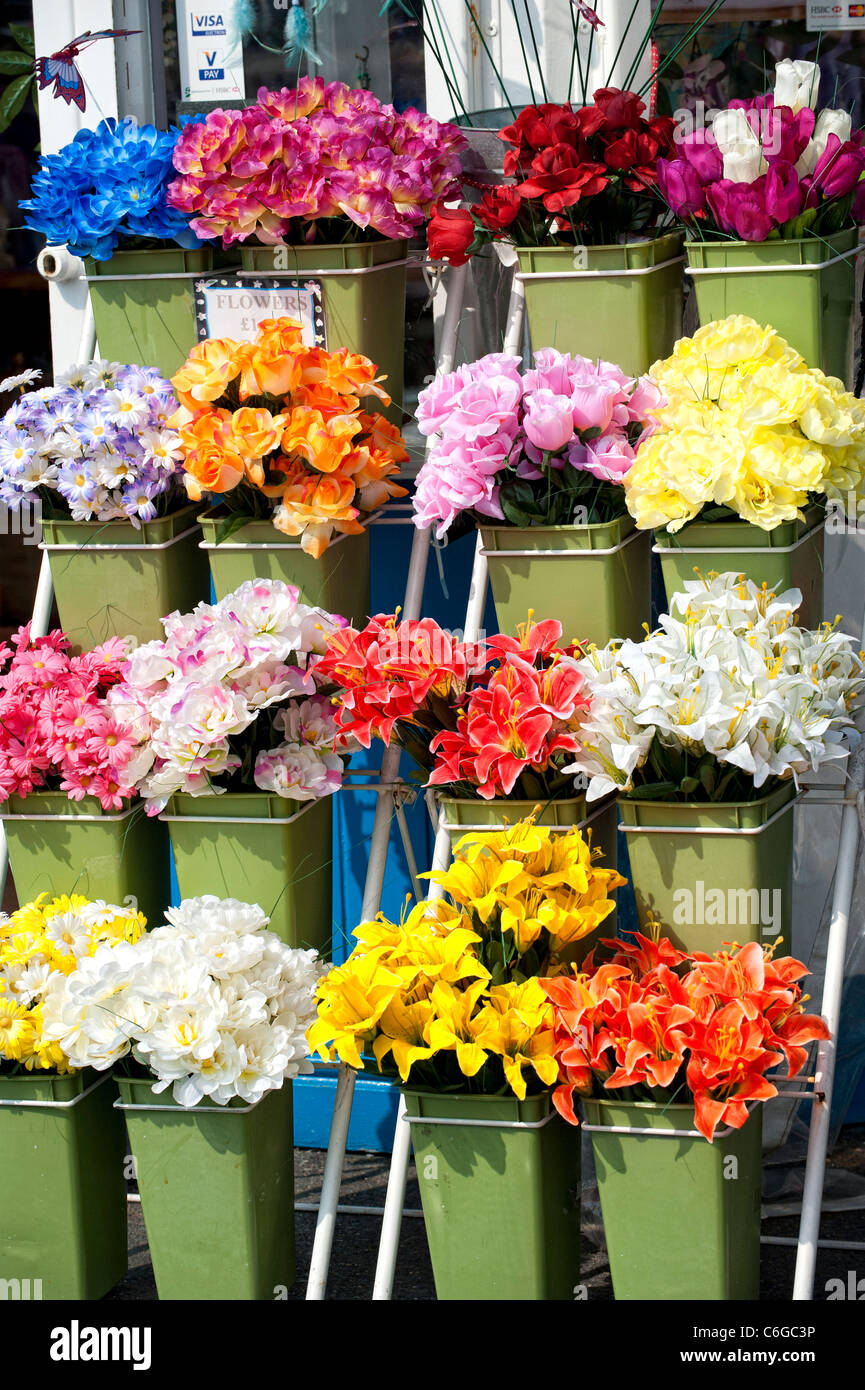 Large display of colourful artificial flowers on stand stock photo large display of colourful artificial flowers on stand mightylinksfo