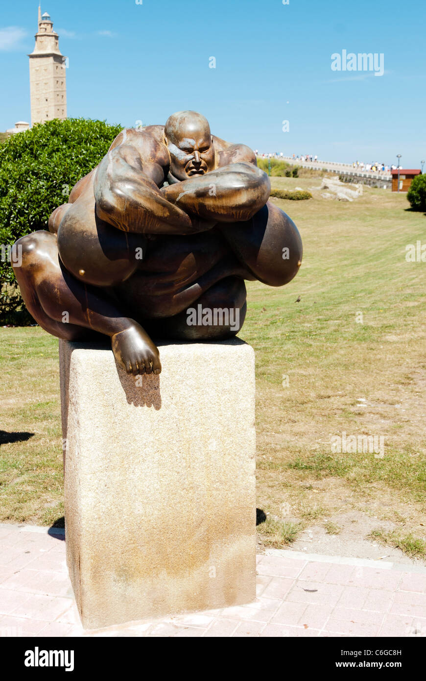 Sculpture near Hercules Tower in La Coruna - Spain  The structure is ancient Roman lighthouse and is 55 metres (180 Stock Photo