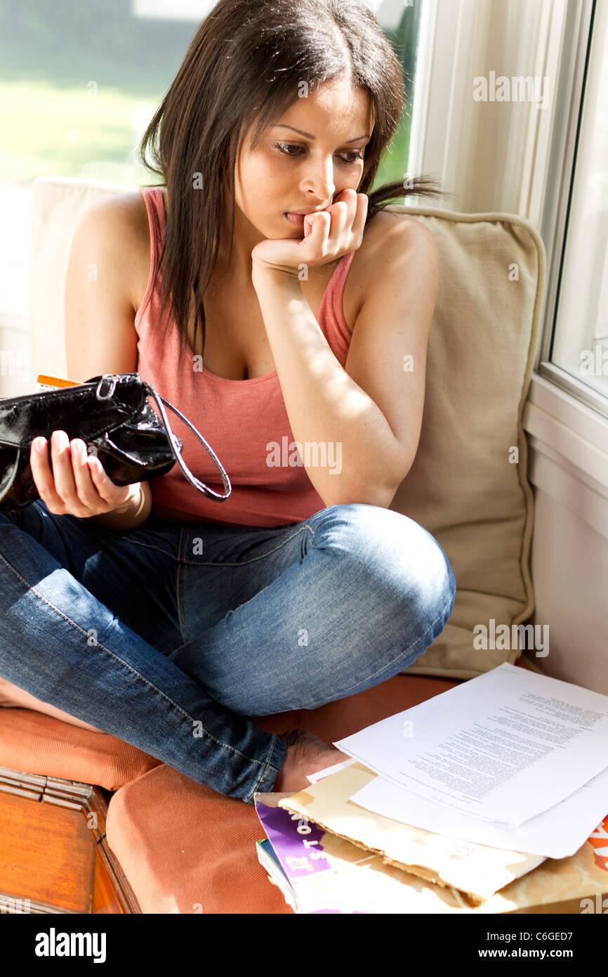 Student checking finances - Stock Image