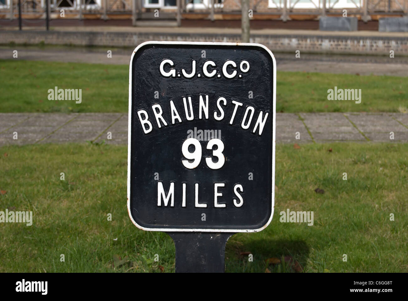 mile marker adjacent to the grand union canal at brentford lock, london, england, giving distance to braunston - Stock Image