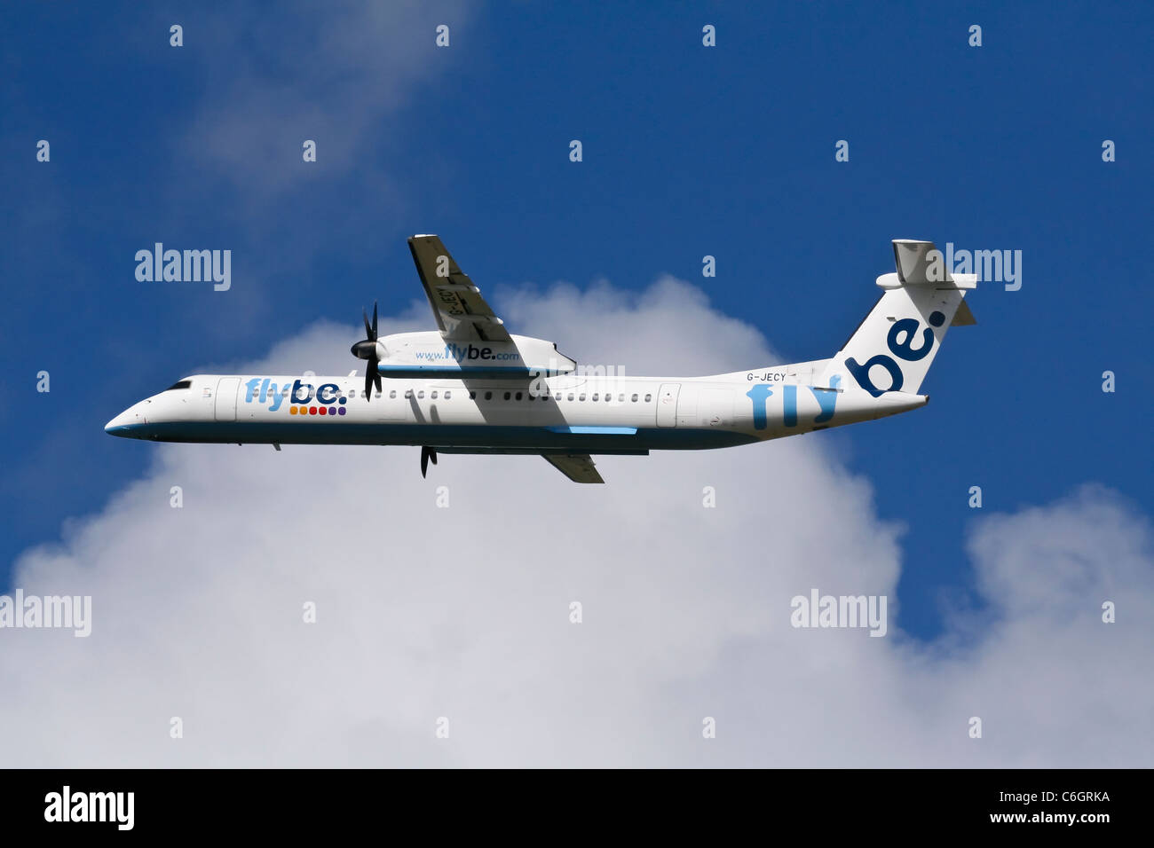 De Havilland Canada DHC-8Q-402 Dash 8 aircraft of Flybe airline just taking off - Stock Image