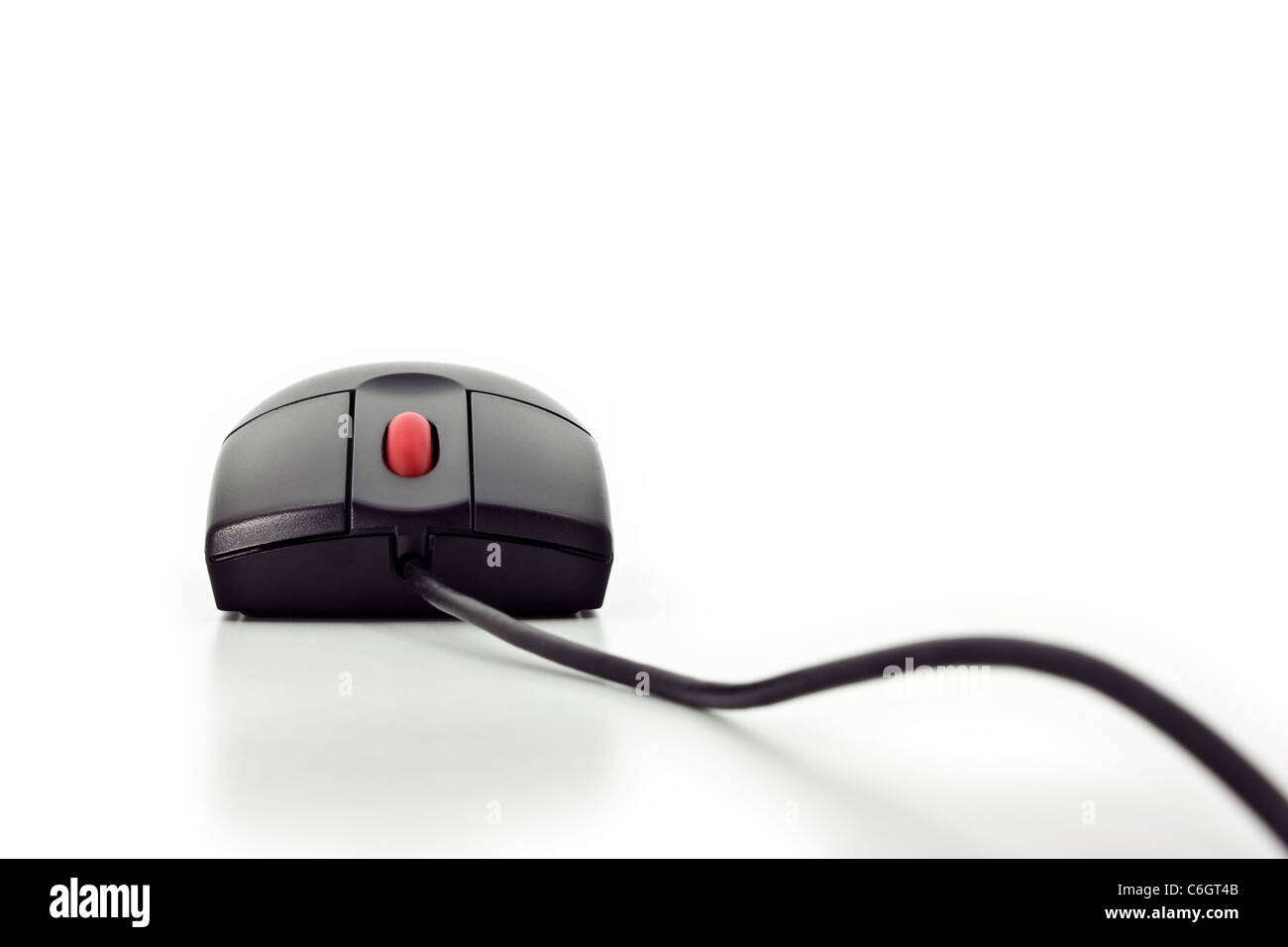 Close front view of a black computer mouse with a red wheel button isolated on white Stock Photo