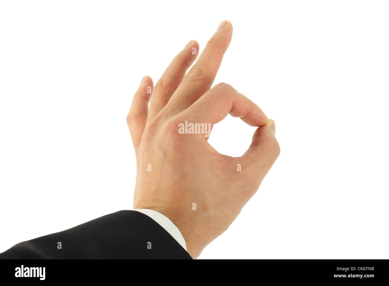 Business man's hand signing okay - Stock Image
