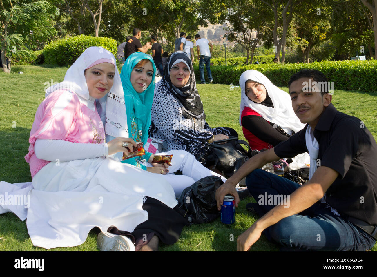Great Family Eid Al-Fitr Feast - family-sitting-on-grass-at-al-azhar-park-celebration-of-the-eid-al-C6GXG4  Best Photo Reference_311310 .jpg