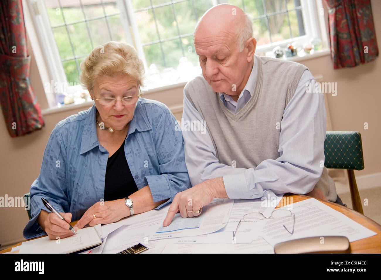 Mature couple working out their finances together - Stock Image