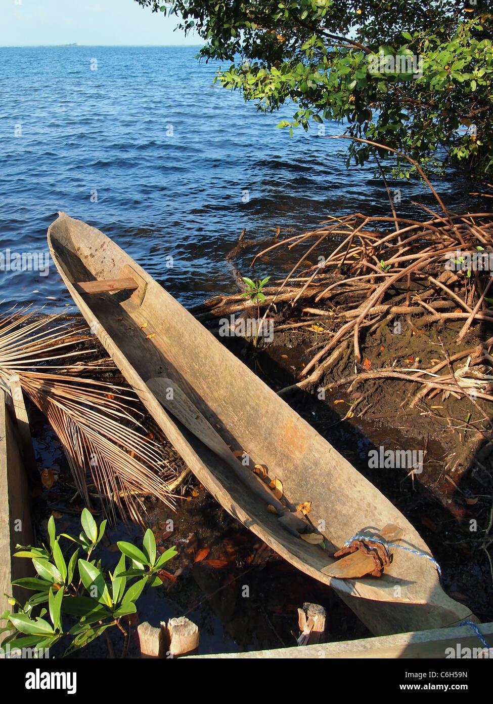 Amerindian dugout canoe in Bocas del Toro, caribbean sea, Panama - Stock Image