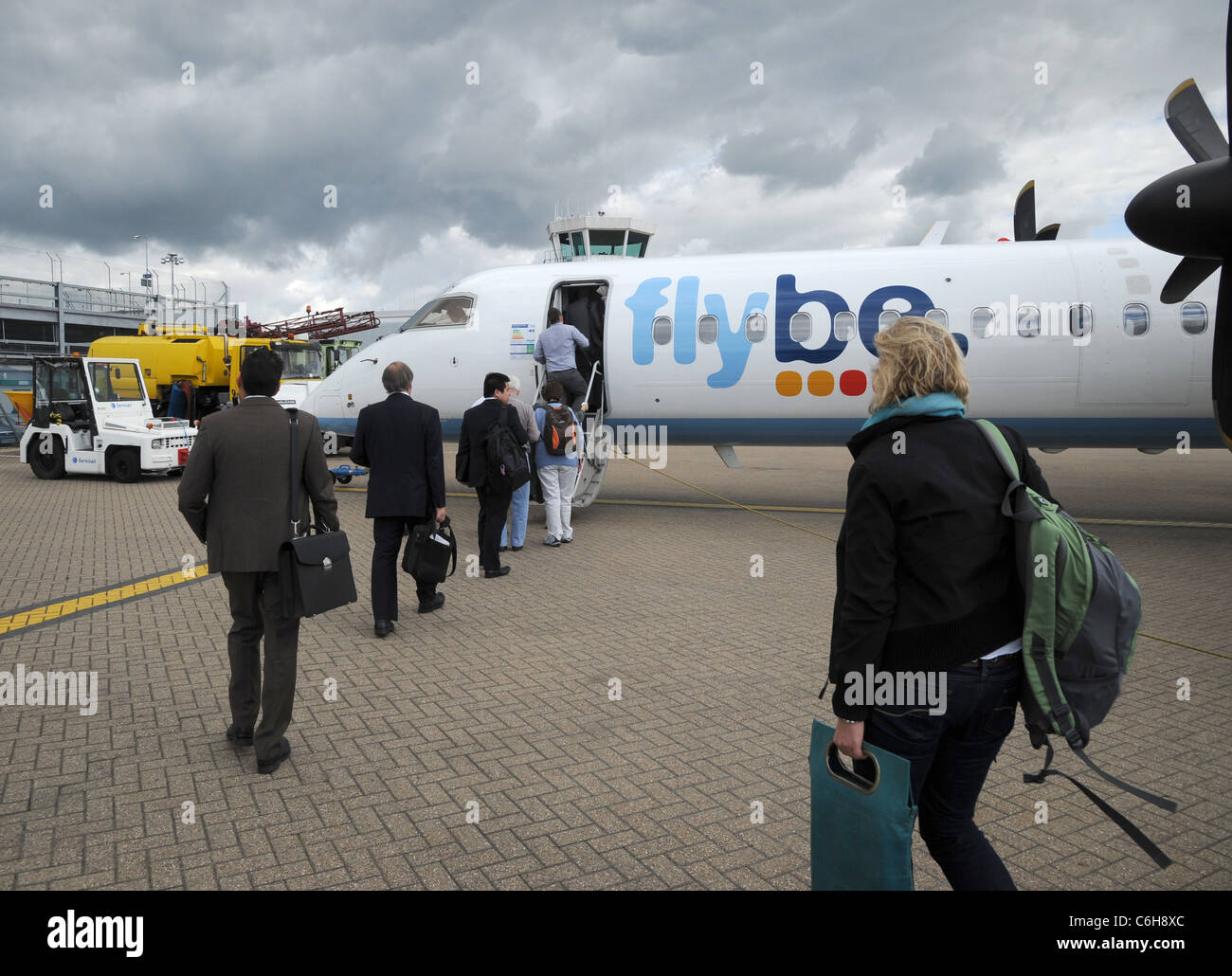 Passengers boarding a FlyBe Bombardier Dash-8 aircraft at Southampton (Eastleigh) international airport, Hampshire, - Stock Image