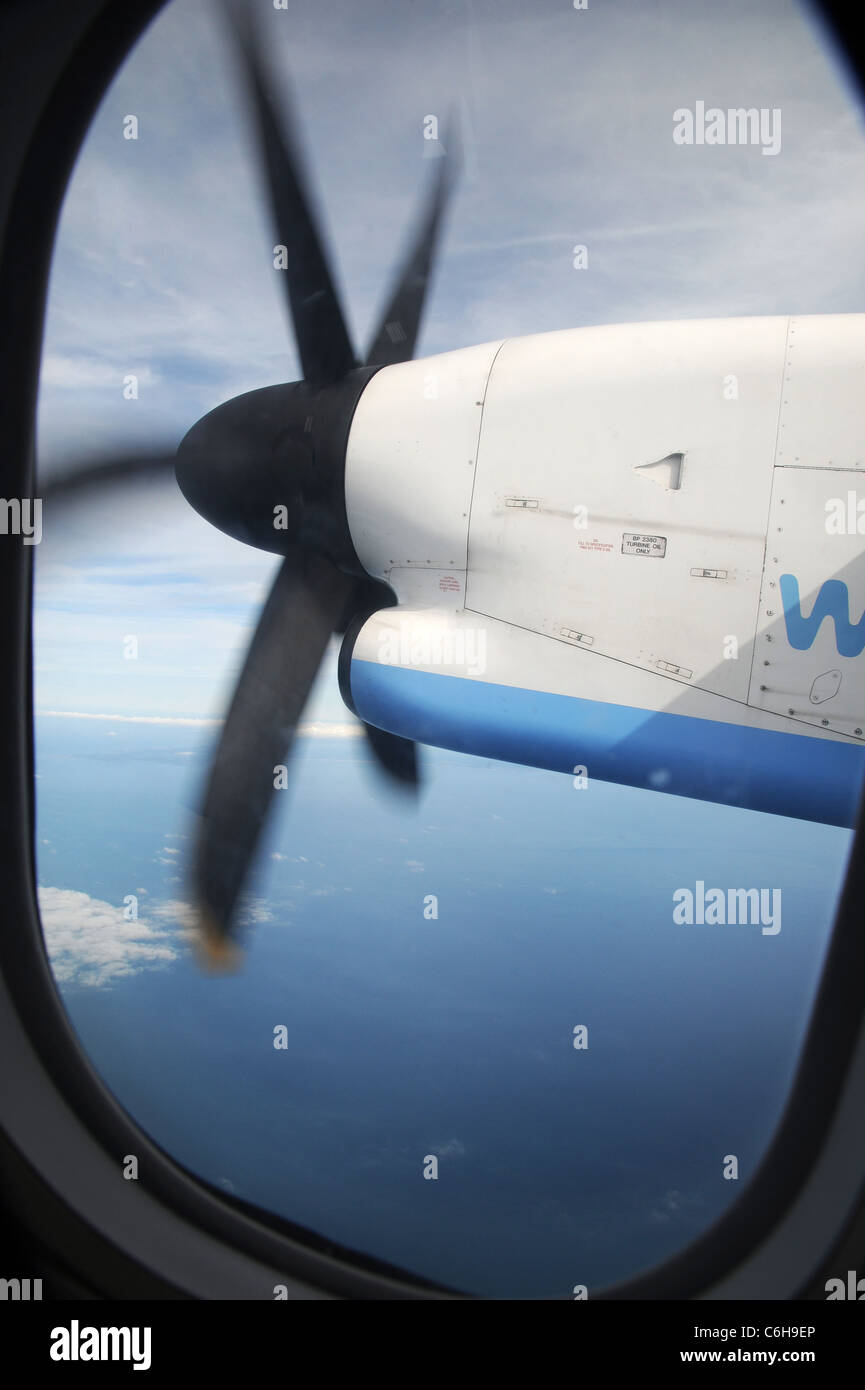 View of the starboard PW123C engine from seat 10D on a FlyBe Bombardier Dash-8 200 aircraft, high over the English - Stock Image