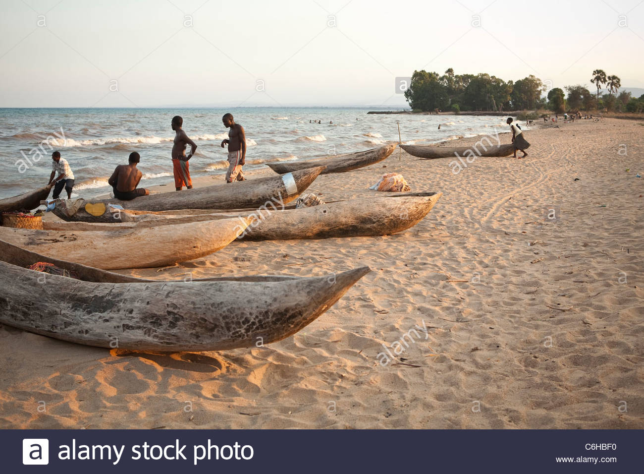 Traditional dugout canoes on the shore of Lake Malawi - Stock Image