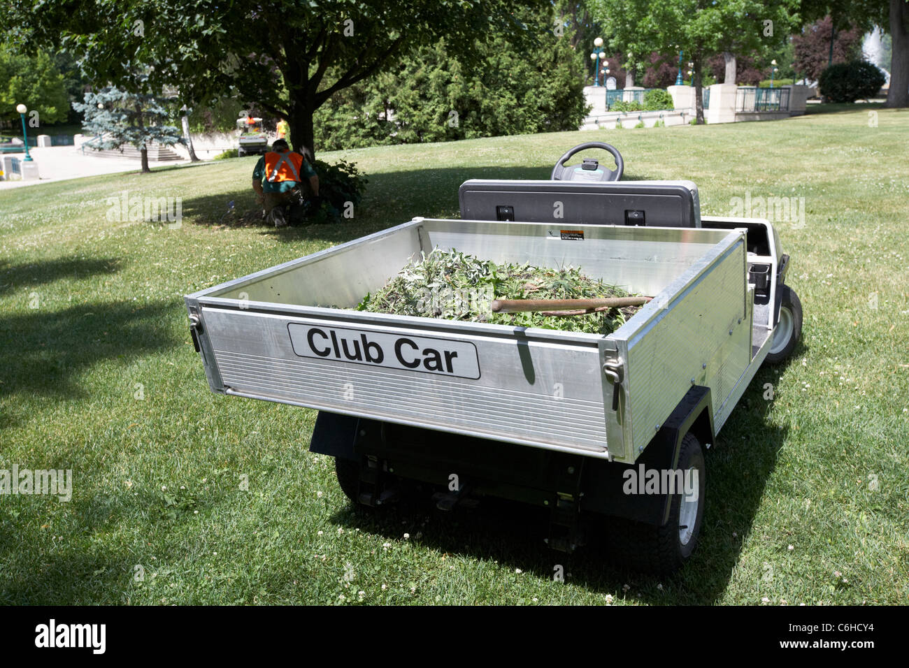 club car utility vehicle being used by gardeners in the grounds of the manitoba legistative building winnipeg manitoba - Stock Image