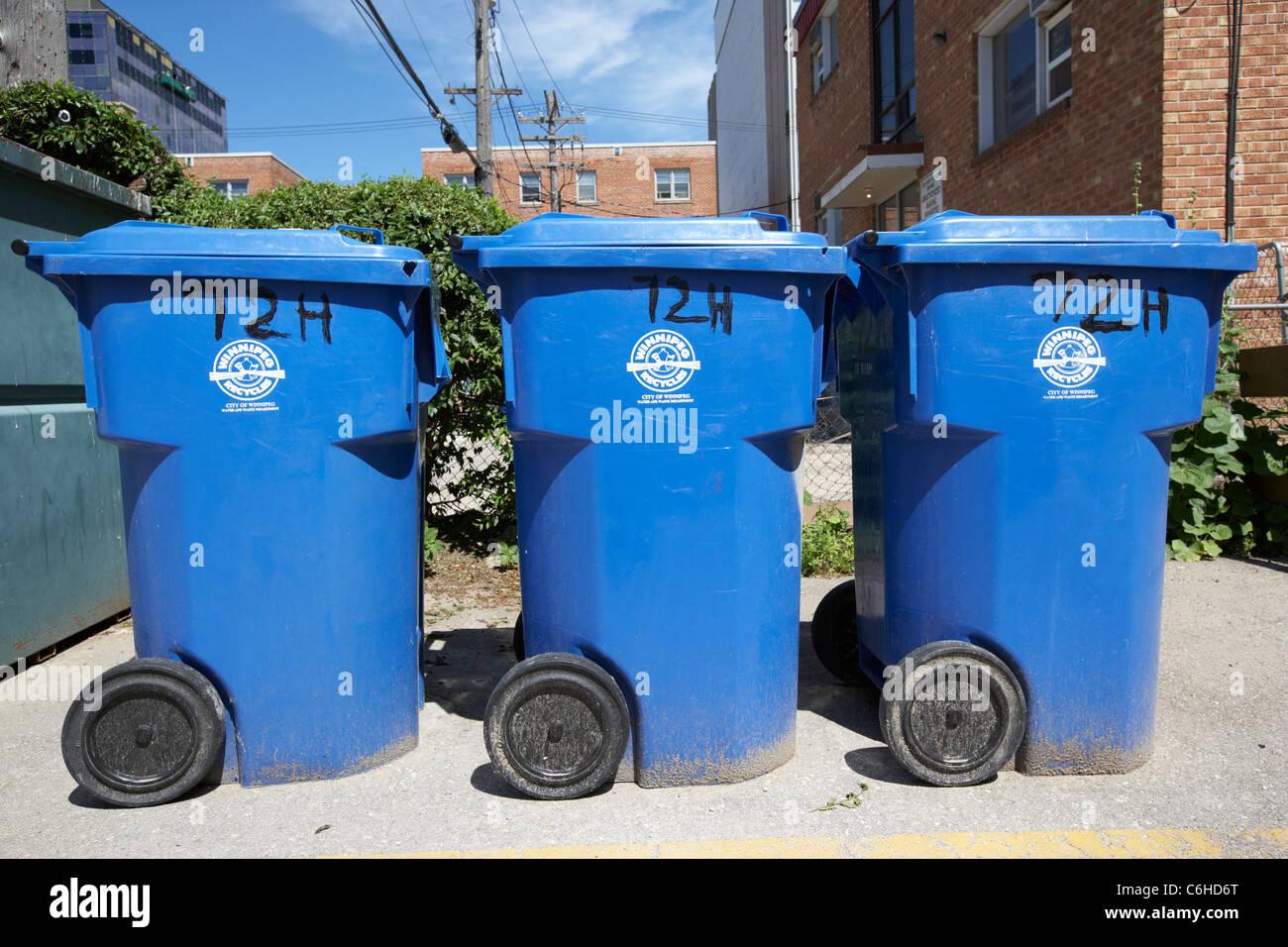 blue city of winnipeg recycling bins manitoba canada Stock Photo