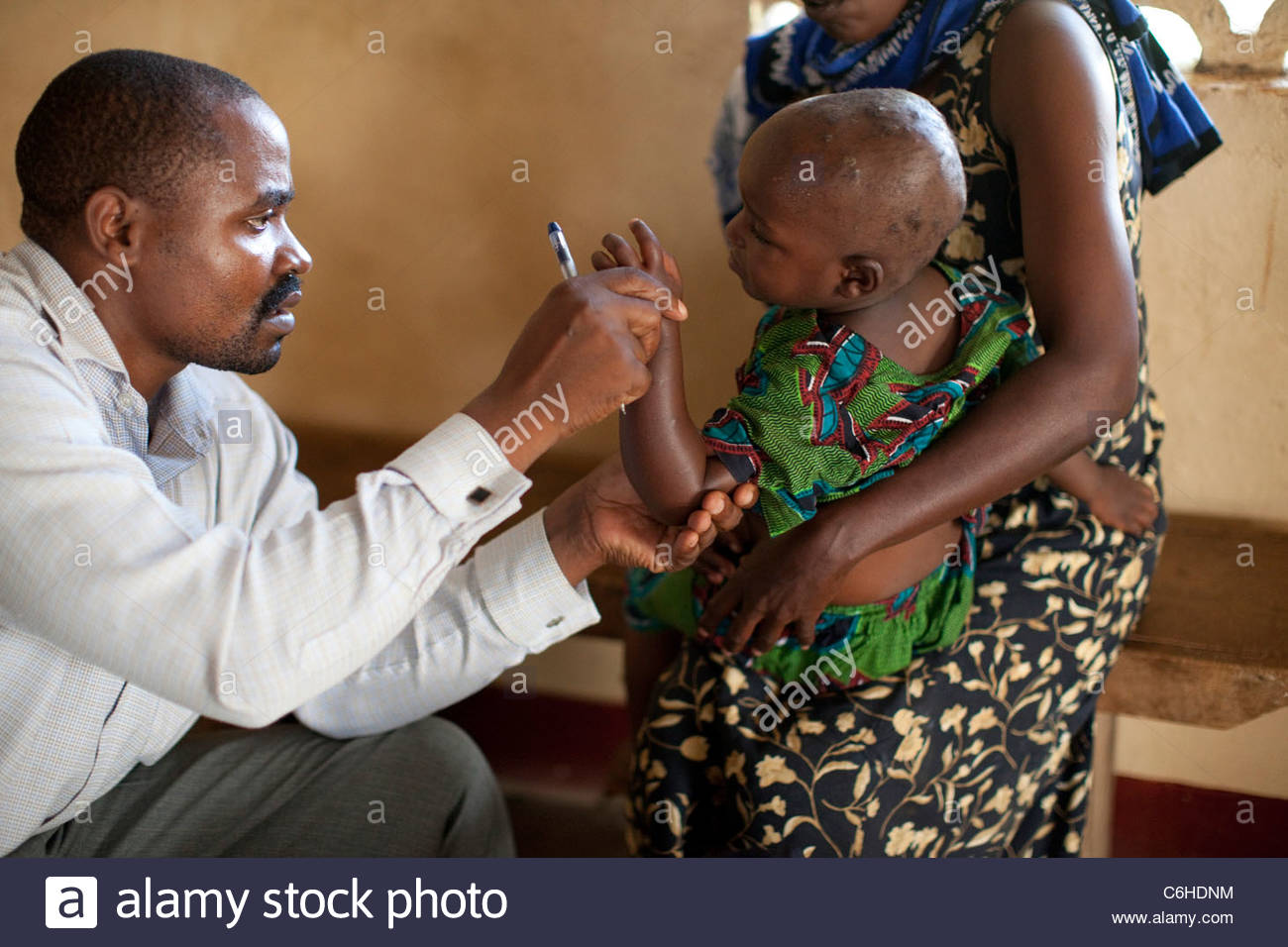 Young child receiving a medical exam - Stock Image